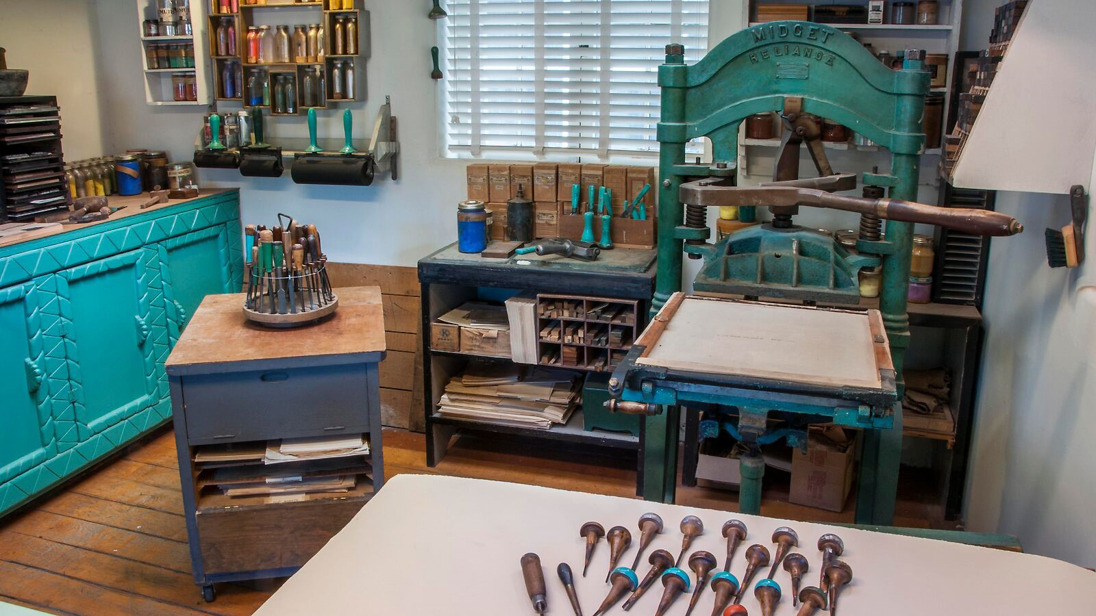 Gustave Baumann's Midget Reliance press, carving tools and pigments. Photo by Blair Clark