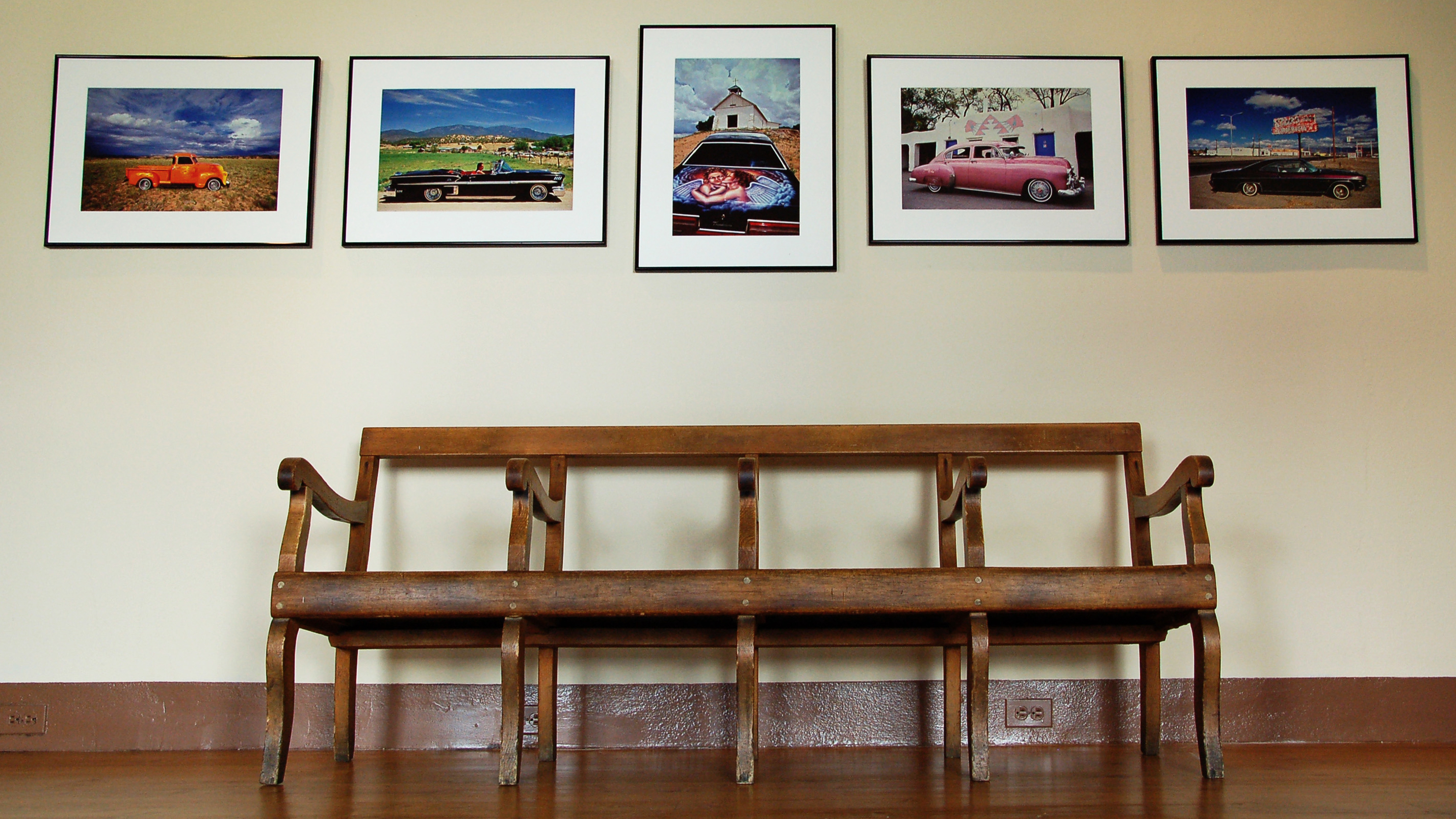 Wooden bench in the Palace of the Governors. Photo by Hannah Abelbeck